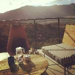 Morning sunrise over the mountains, tea service on private porch