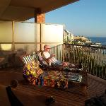 hubby enjoying the late afternoon sun on the balcony