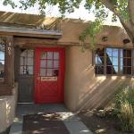 Love the pop of color the red door provides for La Choza