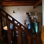 Vista desde el living a la cocina comedor del dpto escalera a las hab