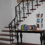 pretty stairwell, mexico travel guides on table and postcards