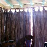 Dusty old drapes to keep the stuffiness in the room