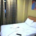 Our room, clean, with a window facing the bus stand