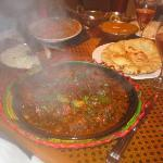 Amazing lamb curry on a sizzling skillet