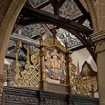 The carved South screen with Prince of Wales feathers and view of ornate plaster ceiling tiles