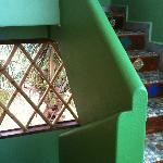 The colourful wall and beautiful tiled stairs