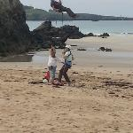 abseiling onto the beach