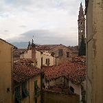 Torre da Santa Maria Novela, montanhas e telhados