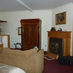 Room #72 - sofa, TV armoire & fireplace