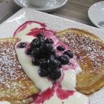 one of 4 choices for breakfast pancakes with a freshly made yogurt, blueberry cream sauce.