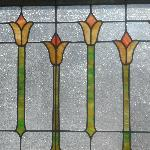 Original handmade stained glass in the dining room of 1922 Starkey House B&B