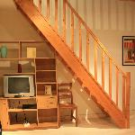 A view of the living room (TV and stairs area)