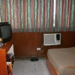 twin-bed room with tv, aircon etc