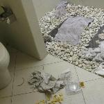 Mess left after repairing toilet