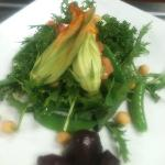Seasonal changing Farm salad with local greens and vegetables