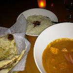 delicious vegetarian curry with nam garlic bread and tasty rice