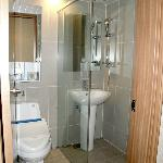 Toilet & sink in shower stall
