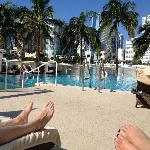 View from sun lounger in pool area.