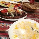Bakhtiari Kebab and rice. Joojeh (Chicken) Kebab in the background