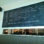 one of several black boards around dining room with wine menu.