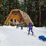 Once the snow falls, guests GET to xc ski or snowshoe 1.5 miles to reach Summit Meadow Cabins