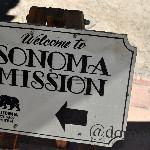A sign leading you to the mission