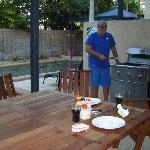 Rog bbqing by the pool