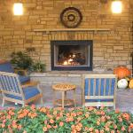 Outdoor fireplace by the back entrance