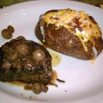 8oz fillet topped with button mushrooms, with baked stuffed potato