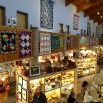 art quilts hanging above the very large and diverse gift shop