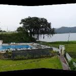 View of pool and lakeside