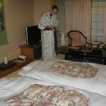 My husband wearing the hotel yukata. The beds were nice and comfy!