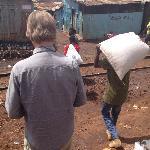 husband passing the railroad in Kibera