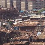 flat for the rich rising behind Kibera, slum with 800.000 people
