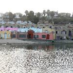Bright cottages along the creek flowing into the Pacific Ocean @ Capitola Beach