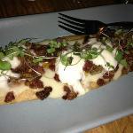 burrata on flat break with pan seared panchetta