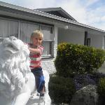 Riding the lions that guard the motel entranceway