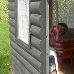 Our son enjoying the playhouse at the back of the section