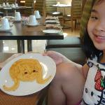 My daughter enjoying the Princess pancake that specially cooked for her by the chef..