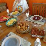 Ms Una's Breakfast: Fresh fruit, eggs, Johnnie cakes, bacon salsa & bacon.