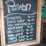 Price list for street food at the entrance of Kampung Daun