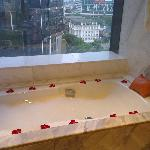 Rose petal decoration on our second day, hot bath with bubbles already run.