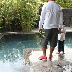 hubby and baby with our pool