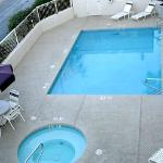 Pool and hot tub on street level, small and private