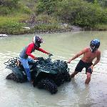 Attempting to get the broken ATV out of the river