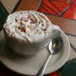 Ghirardelli hot chocolate with whipped cream and sprinkles