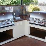 4 huge BBQ Grills. We have grilling kits in the office!