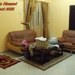 Family Sitting / Small & contain Queen bed in a corner separated with only thin curtain strings