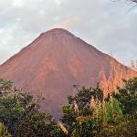 sun setting on volcano