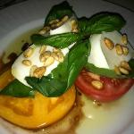 Caprese salad with heirloom tomatoes, buffalo Mozzarella, basil and pine nuts.